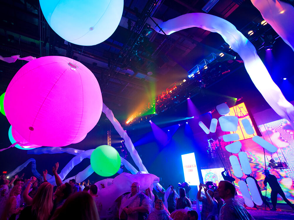 Giant fluorescent balloons bounce through the audience at a Blue Man Group show in Universal's CityWalk.