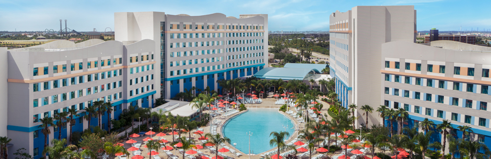 The two hotel towers of Universal's Endless Summer – Surfside Inn and Suites with a large surfboard-shaped pool in between them.