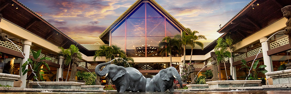 A statue of elephants in a courtyard pond at Loews Royal Pacific Resort.